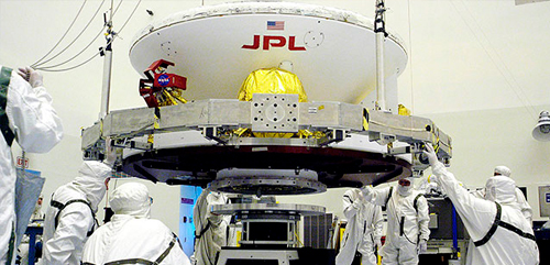 Engineers work on Opportunity (in its cruise configuration) in a cleanroom at Kennedy Space Center